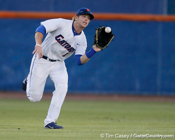 Florida senior Bryson Smith catches a fly ball during the Gators' 7-0 win against the Alabama Crimson Tide on Friday, April 22, 2011 at McKethan Stadium in Gainesville, Fla. / Gator Country photo by Tim Casey