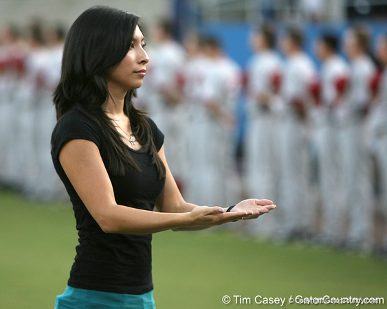 A Florida student signs the national anthem before the Gators' 7-0 win against the Alabama Crimson Tide on Friday, April 22, 2011 at McKethan Stadium in Gainesville, Fla. / Gator Country photo by Tim Casey