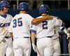 Florida sophomore Brian Johnson congratulates senior Josh Adams after a three run home run during the Gators' 7-0 win against the Alabama Crimson Tide on Friday, April 22, 2011 at McKethan Stadium in Gainesville, Fla. / Gator Country photo by Tim Casey