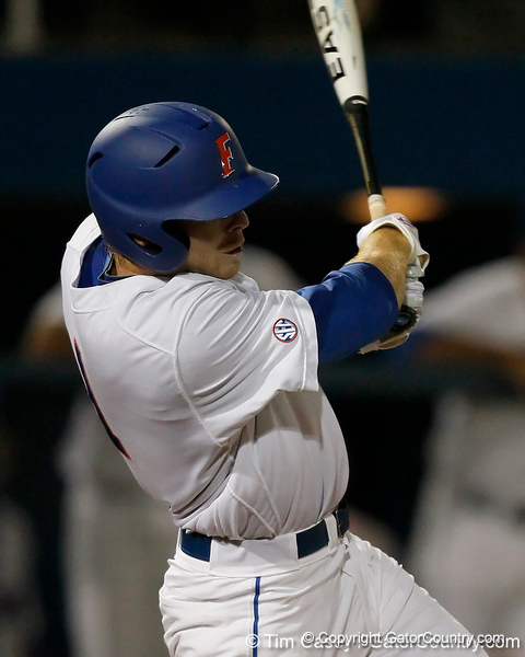Florida senior Bryson Smith follows through on a hit during the Gators' 7-0 win against the Alabama Crimson Tide on Friday, April 22, 2011 at McKethan Stadium in Gainesville, Fla. / Gator Country photo by Tim Casey