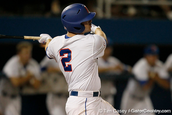Florida senior Josh Adams follows through on a three-run homer during the Gators' 7-0 win against the Alabama Crimson Tide on Friday, April 22, 2011 at McKethan Stadium in Gainesville, Fla. / Gator Country photo by Tim Casey