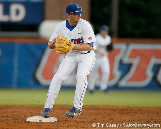 Florida senior Josh Adams turns a double play during the Gators' 7-0 win against the Alabama Crimson Tide on Friday, April 22, 2011 at McKethan Stadium in Gainesville, Fla. / Gator Country photo by Tim Casey