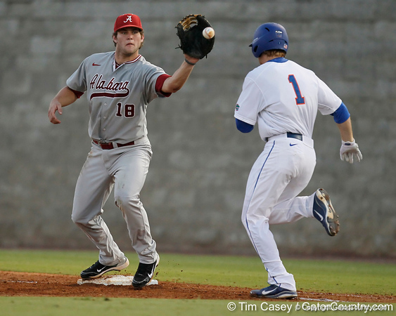 Florida senior Bryson Smith is thrown out at first base as Austen Smith catches the ball during the Gators' 7-0 win against the Alabama Crimson Tide on Friday, April 22, 2011 at McKethan Stadium in Gainesville, Fla. / Gator Country photo by Tim Casey