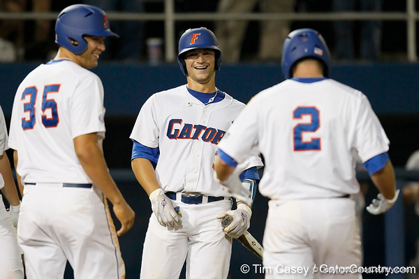 Florida sophomore catcher Mike Zunino congratulates senior Josh Adams after a three run home run during the Gators' 7-0 win against the Alabama Crimson Tide on Friday, April 22, 2011 at McKethan Stadium in Gainesville, Fla. / Gator Country photo by Tim Casey