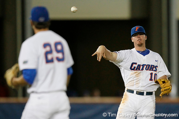 Florida sophomore Austin Maddox throws the ball to senior pitcher Matt Campbell after a strikeout during the Gators' 7-0 win against the Alabama Crimson Tide on Friday, April 22, 2011 at McKethan Stadium in Gainesville, Fla. / Gator Country photo by Tim Casey