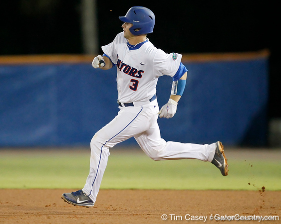 Florida sophomore catcher Mike Zunino runs to second base on a double during the Gators' 7-0 win against the Alabama Crimson Tide on Friday, April 22, 2011 at McKethan Stadium in Gainesville, Fla. / Gator Country photo by Tim Casey