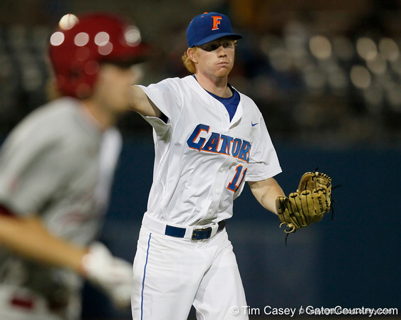 Florida sophomore pitcher Hudson Randall throws to first base during the Gators' 7-0 win against the Alabama Crimson Tide on Friday, April 22, 2011 at McKethan Stadium in Gainesville, Fla. / Gator Country photo by Tim Casey