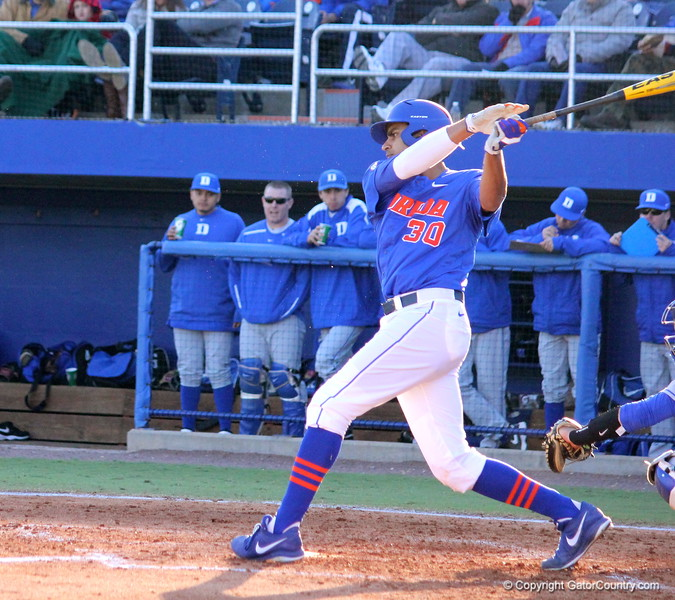 Senior Vickash Ramjit swinging the bat during the Gators' 4-2 win against Duke on Saturday, February 16, 2013 at McKethan Stadium in Gainesville, Fla. / Gator Country photo by Danielle Bloch