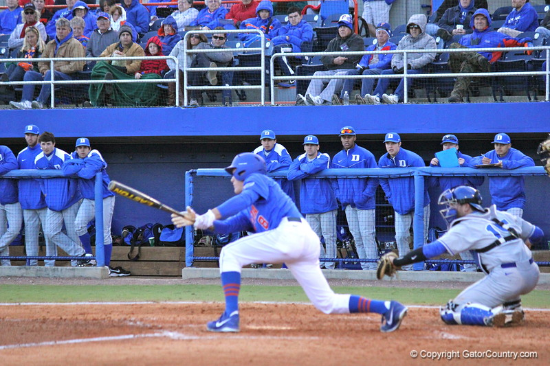 Freshman Harrison Bader mid swing during the Gators' 4-2 win against Duke on Saturday, February 16, 2013 at McKethan Stadium in Gainesville, Fla. / Gator Country photo by Danielle Bloch
