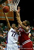ATLANTA - MARCH 11:  Darian Townes #5 of the Arkansas Razorbacks tries to block Taurean Green #11 of the Florida Gators during the championship game of the Southeastern Conference Men's Basketball Tournament on March 11, 2007 at the Georgia Dome in Atlanta, Georgia.  (Photo by Streeter Lecka/Getty Images)