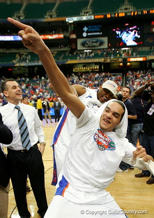 ATLANTA - MARCH 11:  Head coach Billy Donovan, Joakim Noah #13 and Al Horford #42 of the Florida Gators celebrate after a 77-56 victory over the Arkansas Razorbacks in the championship game of the Southeastern Conference Men's Basketball Tournament on March 11, 2007 at the Georgia Dome in Atlanta, Georgia.  (Photo by Streeter Lecka/Getty Images)