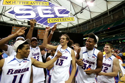 ATLANTA - MARCH 11:  The Florida Gators celebrate after a 77-56 victory over the Arkansas Razorbacks in the championship game of the Southeastern Conference Men's Basketball Tournament on March 11, 2007 at the Georgia Dome in Atlanta, Georgia.  (Photo by Streeter Lecka/Getty Images)