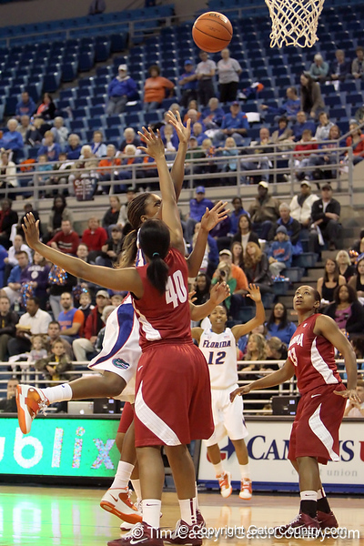 Florida redshirt-junior forward Ndidi Madu gets fouled during the first half of the Gators' 70-64 win against the Alabama Crimson Tide on Thursday, January 27, 2011 at the Stephen C. O'Connell Center in Gainesville, Fla. / Gator Country photo by Tim Casey