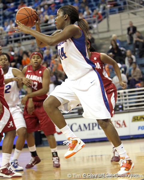 Florida redshirt-junior forward Ndidi Madu passes during the first half of the Gators' 70-64 win against the Alabama Crimson Tide on Thursday, January 27, 2011 at the Stephen C. O'Connell Center in Gainesville, Fla. / Gator Country photo by Tim Casey