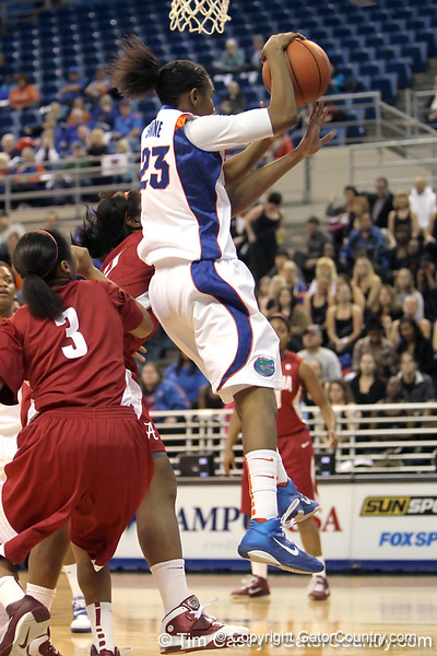 Florida freshman guard Brittany Shine grabs an offensive rebound during the first half of the Gators' 70-64 win against the Alabama Crimson Tide on Thursday, January 27, 2011 at the Stephen C. O'Connell Center in Gainesville, Fla. / Gator Country photo by Tim Casey