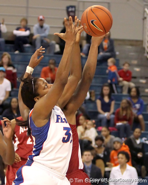 Florida sophomore forward Jennifer George grabs an offensive rebound during the second half of the Gators' 70-64 win against the Alabama Crimson Tide on Thursday, January 27, 2011 at the Stephen C. O'Connell Center in Gainesville, Fla. / Gator Country photo by Tim Casey