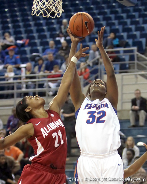 Florida sophomore forward Jennifer George gets fouled while shooting during the first half of the Gators' 70-64 win against the Alabama Crimson Tide on Thursday, January 27, 2011 at the Stephen C. O'Connell Center in Gainesville, Fla. / Gator Country photo by Tim Casey