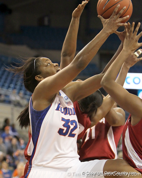 Florida sophomore forward Jennifer George gets fouled while shooting a layup during the second half of the Gators' 70-64 win against the Alabama Crimson Tide on Thursday, January 27, 2011 at the Stephen C. O'Connell Center in Gainesville, Fla. / Gator Country photo by Tim Casey
