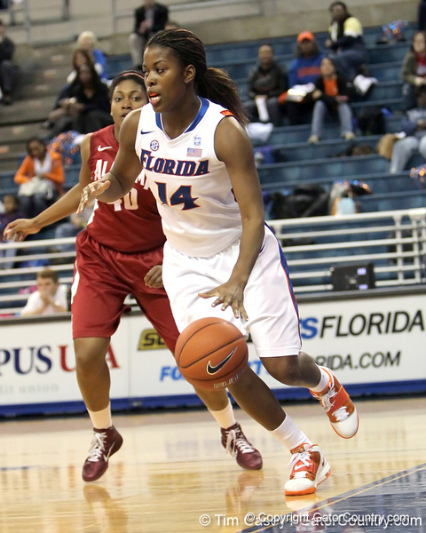 Florida redshirt-junior forward Ndidi Madu dribbles along the baseline during the first half of the Gators' 70-64 win against the Alabama Crimson Tide on Thursday, January 27, 2011 at the Stephen C. O'Connell Center in Gainesville, Fla. / Gator Country photo by Tim Casey