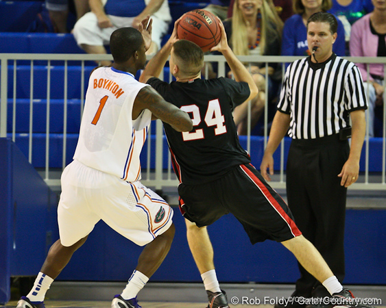 Florida junior guard Kenny Boynton defends Catholic's Billy Donovan during the Gators' 114-57 win over the Catholic Cardinals on Thursday, November 3rd, 2011 at the Steven C. O'Connell Center in Gainesville, Fla./Gator Country photo by Rob Foldy