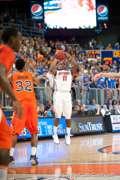 Florida senior guard Erving Walker shoots a 3 during the Gators' 63-47 win against the Auburn Tigers on Tuesday, February 21, 2012 at the Stephen C. O'Connell Center in Gainesville, Fla. / Gator Country photo by Saj Guevara