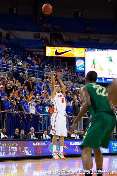 Florida sophomore guard Scottie Wilbekin follows through on a shot during the first half of the Gators' 79-61 win against the UAB Blazers on Tuesday at the Stephen C. O'Connell Center in Gainesville, Fla. / photo by Matt Pendleton