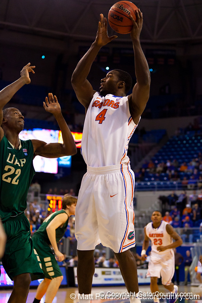 Florida sophomore center Patric Young puts up a shot during the first half of the Gators' 79-61 win against the UAB Blazers on Tuesday at the Stephen C. O'Connell Center in Gainesville, Fla. / photo by Matt Pendleton