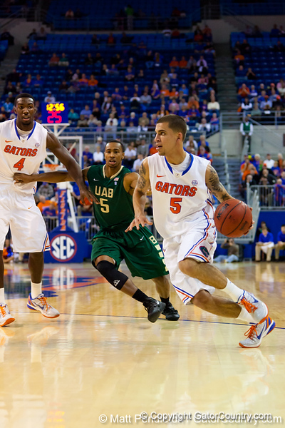 Florida sophomore guard Scottie Wilbekin dribbles towards the basket during the first half of the Gators' 79-61 win against the UAB Blazers on Tuesday at the Stephen C. O'Connell Center in Gainesville, Fla. / photo by Matt Pendleton