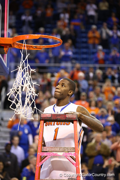 Kenny Boynton cuts down the net during Florida's 66-40 win over Vanderbilt on March 6, 2013 at the Stephen C O'Connell Center in Gainesville, Florida. Photos by Curtiss Bryant for Gatorcountry.com