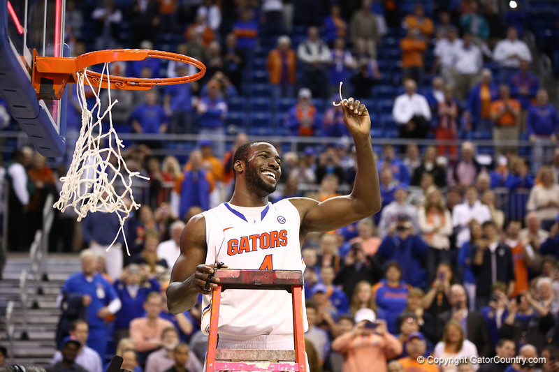 Patric Young cuts down the net during Florida's 66-40 win over Vanderbilt on March 6, 2013 at the Stephen C O'Connell Center in Gainesville, Florida. Photos by Curtiss Bryant for Gatorcountry.com