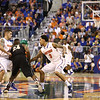 Mike Rosario and Scottie Wilbekin try to steal the ball during Florida's 66-40 win over Vanderbilt on March 6, 2013 at the Stephen C O'Connell Center in Gainesville, Florida. Photos by Curtiss Bryant for Gatorcountry.com