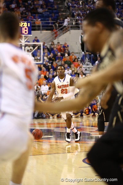 Michael Frazier looks to pass during Florida's 66-40 win over Vanderbilt on March 6, 2013 at the Stephen C O'Connell Center in Gainesville, Florida. Photos by Curtiss Bryant for Gatorcountry.com