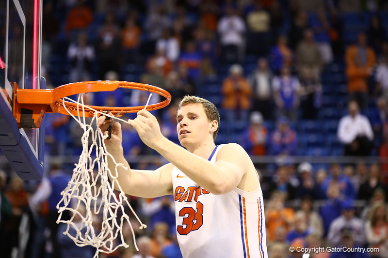 Erik Murphy cuts down the net during Florida's 66-40 win over Vanderbilt on March 6, 2013 at the Stephen C O'Connell Center in Gainesville, Florida. Photos by Curtiss Bryant for Gatorcountry.com