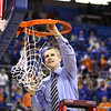 Coach Billy Donovon cuts down the net during Florida's 66-40 win over Vanderbilt on March 6, 2013 at the Stephen C O'Connell Center in Gainesville, Florida. Photos by Curtiss Bryant for Gatorcountry.com
