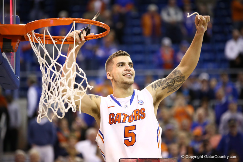 Scottie Wilbekin cuts down the net during Florida's 66-40 win over Vanderbilt on March 6, 2013 at the Stephen C O'Connell Center in Gainesville, Florida. Photos by Curtiss Bryant for Gatorcountry.com