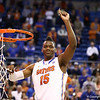 Will Yeguete cuts down the net during Florida's 66-40 win over Vanderbilt on March 6, 2013 at the Stephen C O'Connell Center in Gainesville, Florida. Photos by Curtiss Bryant for Gatorcountry.com