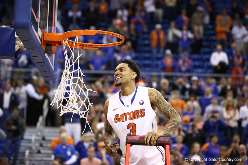 Mike Rosario cuts down the net during Florida's 66-40 win over Vanderbilt on March 6, 2013 at the Stephen C O'Connell Center in Gainesville, Florida. Photos by Curtiss Bryant for Gatorcountry.com