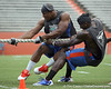 Florida junior linebacker Jonathan Bostic and redshirt junior receiver Omarius Hines compete in the tug of war during the Gator Charity Challenge event on Friday, July 29, 2011 at Ben Hill Griffin Stadium in Gainesville, Fla. / Gator Country photo by Tim Casey