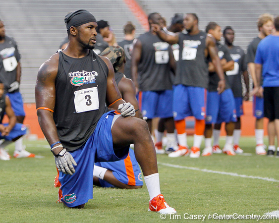 Florida redshirt sophomore linebacker Jelani Jenkins prepares to do push-ups during the Gator Charity Challenge event on Friday, July 29, 2011 at Ben Hill Griffin Stadium in Gainesville, Fla. / Gator Country photo by Tim Casey