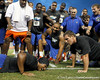 Florida redshirt junior cornerback Jeremy Brown loses to sophomore fullback Jesse Schmitt in a pushup contest during the Gator Charity Challenge event on Friday, July 29, 2011 at Ben Hill Griffin Stadium in Gainesville, Fla. / Gator Country photo by Tim Casey