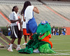 Albert tackles Florida women's basketball player Azania Stewart during the Gator Charity Challenge event on Friday, July 29, 2011 at Ben Hill Griffin Stadium in Gainesville, Fla. / Gator Country photo by Tim Casey