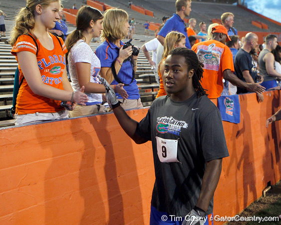 Florida sophomore safety Joshua Shaw slaps hands with fans during the Gator Charity Challenge event on Friday, July 29, 2011 at Ben Hill Griffin Stadium in Gainesville, Fla. / Gator Country photo by Tim Casey