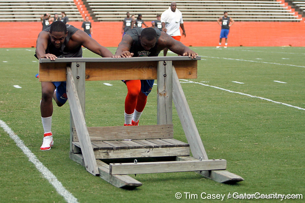 Florida senior defensive end William Green and redshirt junior defensive end Lerentee McCray push the sled during the Gator Charity Challenge event on Friday, July 29, 2011 at Ben Hill Griffin Stadium in Gainesville, Fla. / Gator Country photo by Tim Casey