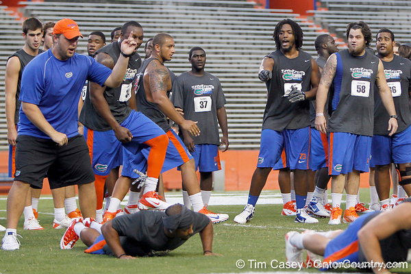 Florida junior tackle Xavier Nixon points to Jeremy Brown during the Gator Charity Challenge event on Friday, July 29, 2011 at Ben Hill Griffin Stadium in Gainesville, Fla. / Gator Country photo by Tim Casey