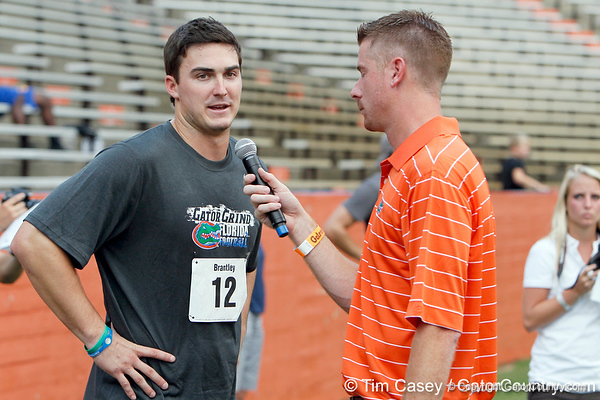 Florida redshirt senior quarterback John Brantley talks with Jeff Cardozo during the Gator Charity Challenge event on Friday, July 29, 2011 at Ben Hill Griffin Stadium in Gainesville, Fla. / Gator Country photo by Tim Casey