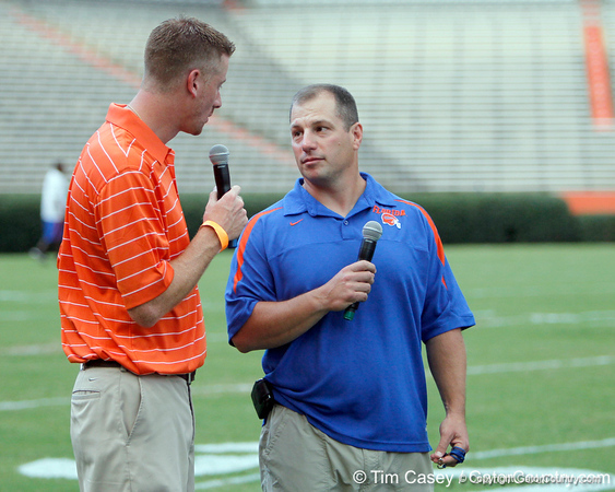 Jeff Cardozo talks with Florida director of strength and conditioning Mickey Marotti during the Gator Charity Challenge event on Friday, July 29, 2011 at Ben Hill Griffin Stadium in Gainesville, Fla. / Gator Country photo by Tim Casey