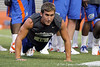 Florida senior kicker Caleb Sturgis does a push-up during the Gator Charity Challenge event on Friday, July 29, 2011 at Ben Hill Griffin Stadium in Gainesville, Fla. / Gator Country photo by Tim Casey