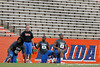 Xavier Nixon, Hygens Succes and Michael Taylor stretch during the Gator Charity Challenge event on Friday, July 29, 2011 at Ben Hill Griffin Stadium in Gainesville, Fla. / Gator Country photo by Tim Casey