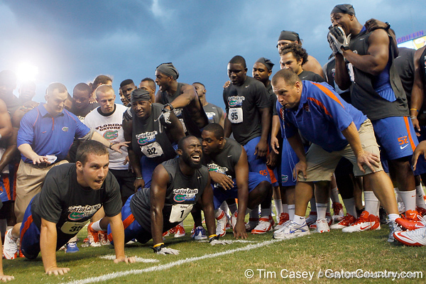 Florida sophomore fullback Jesse Schmitt and redshirt senior running back/receiver Chris Rainey do push-ups during the Gator Charity Challenge event on Friday, July 29, 2011 at Ben Hill Griffin Stadium in Gainesville, Fla. / Gator Country photo by Tim Casey