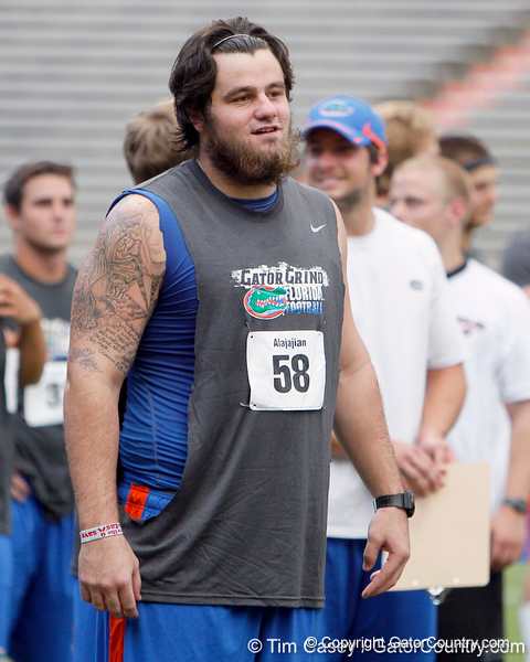 Florida redshirt sophomore center Nick Alajajian talks with teammates during the Gator Charity Challenge event on Friday, July 29, 2011 at Ben Hill Griffin Stadium in Gainesville, Fla. / Gator Country photo by Tim Casey